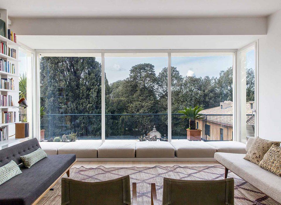 Interior view of Rome villa with skyline windows