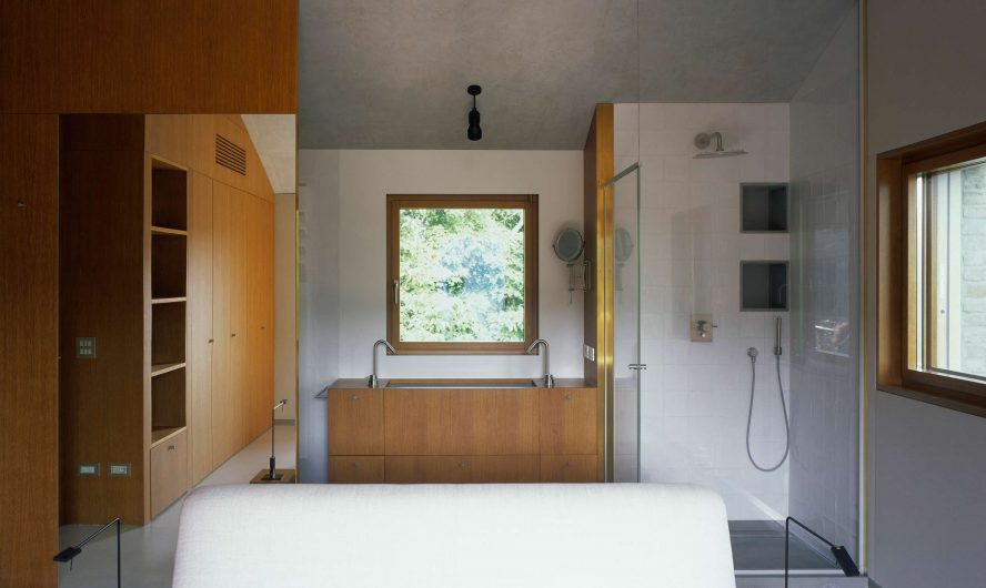 View of the bathroom with single leaf window on the back wall