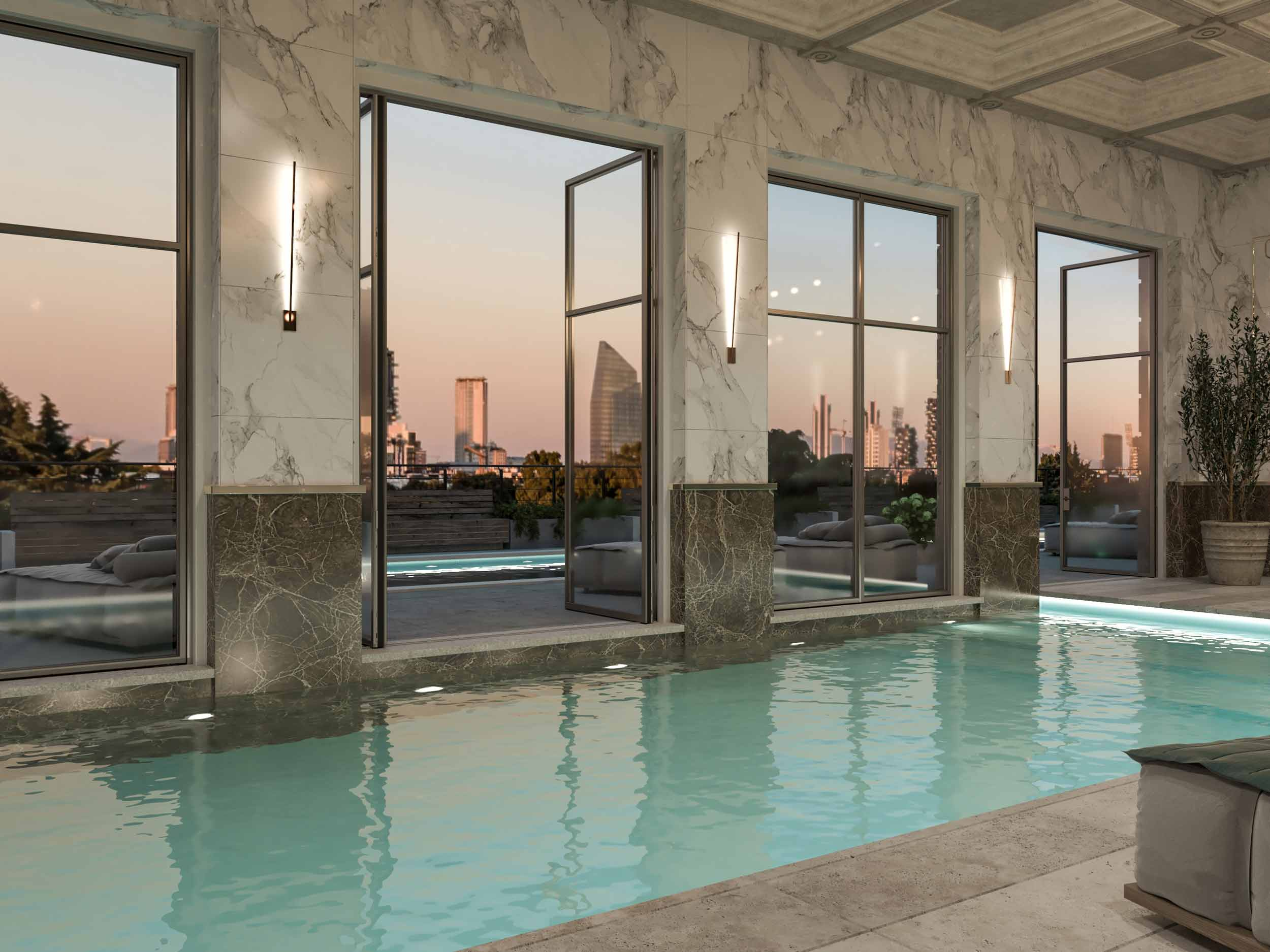 View of an indoor pool with Skyline Metal double-leaf pivot windows