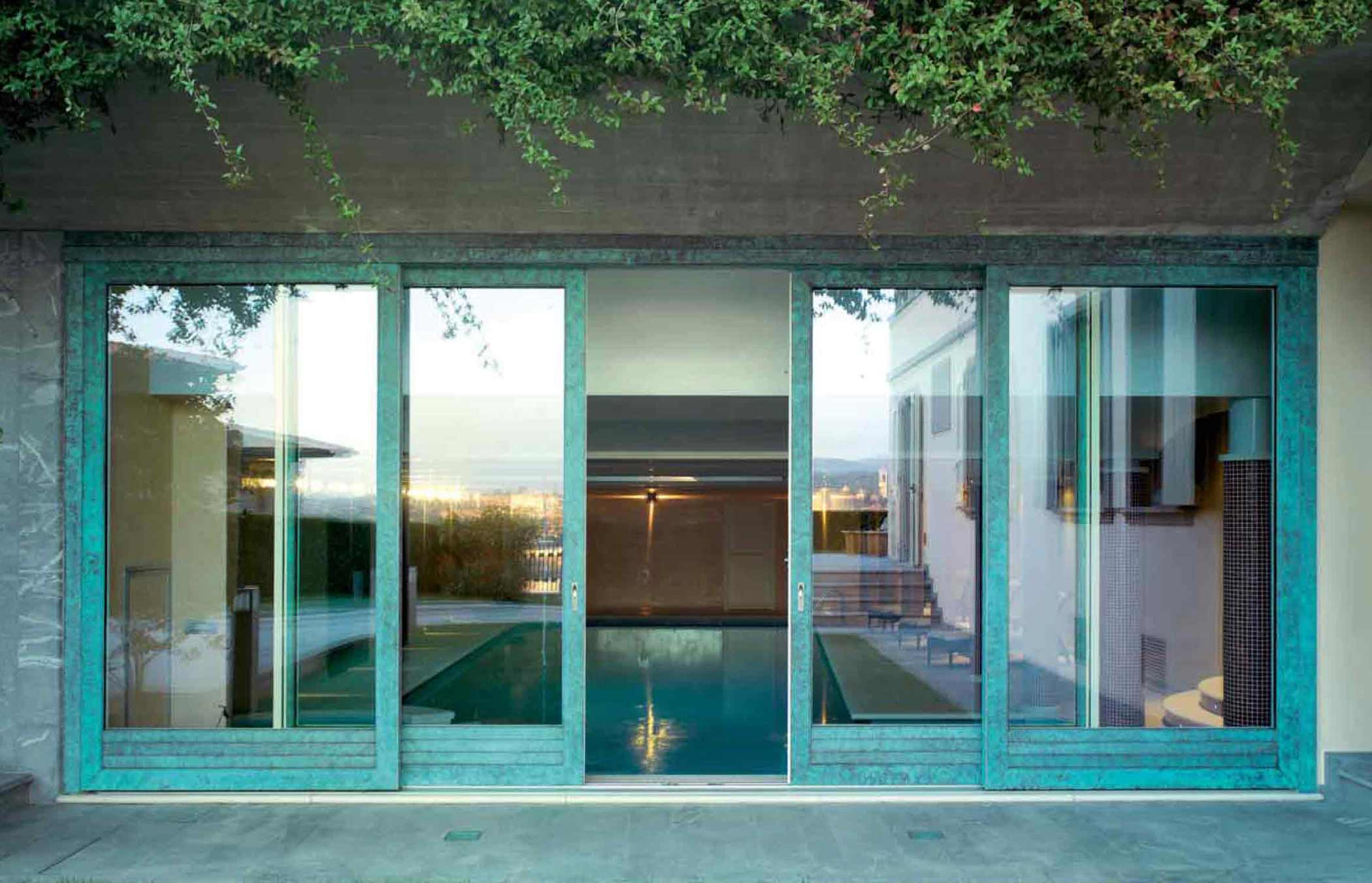 View of a wooden sliding door with the external coppered bronze cladding