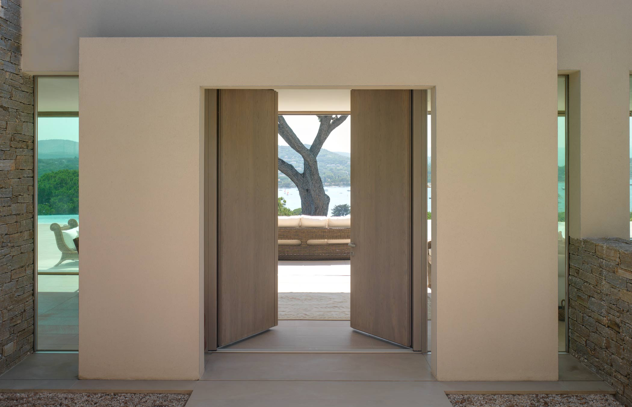 External view of a Saint Tropez model door in smooth wood