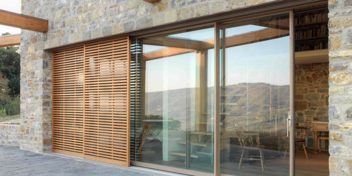 External view of a wooden lift and slide with sliding brise soleil