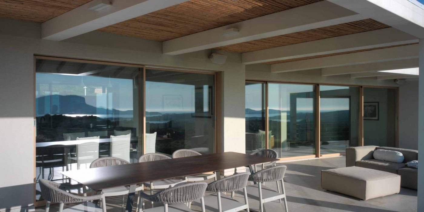 View of two wooden lift and slide doors with a minimal profile