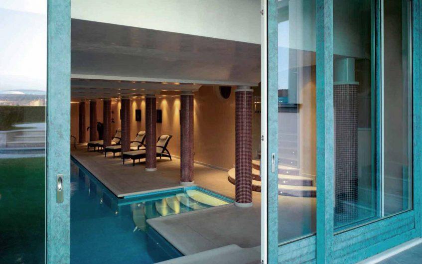 Cover image of Villa Bergamo with lift and slide copper bronze finish