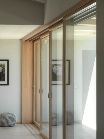 Detail of the closed four-sashes wooden sliding door