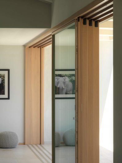 Detail of the open four-ashes wooden sliding door