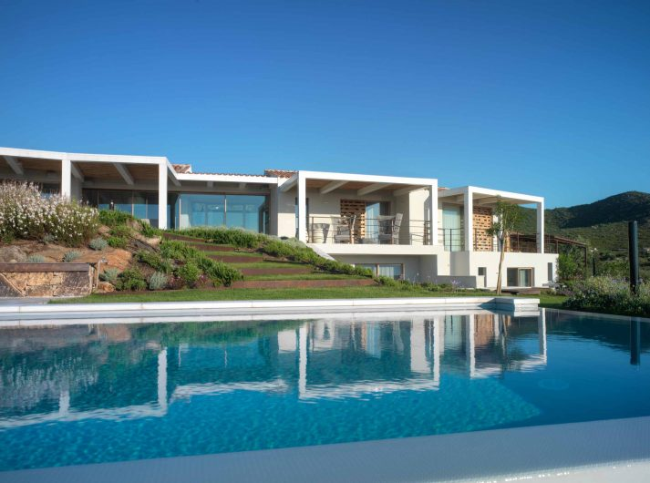 View on the wooden lift and slide doors of the main facade of Villa Costa Smeralda