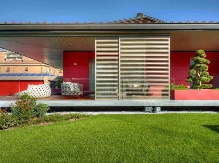 Villa Modena, view of the façade with sliding wooden brise soleil