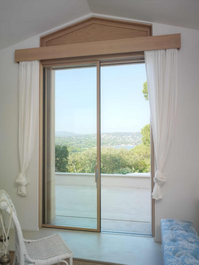 View of the lift and slide with single sash hidden in the wall with wooden profiles