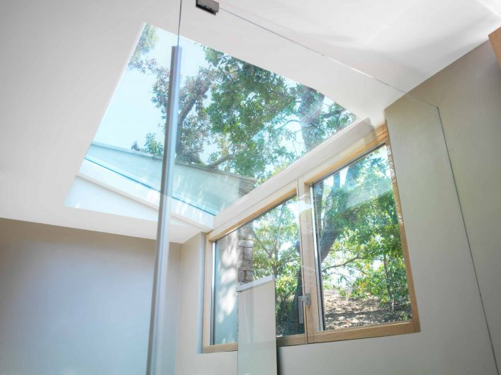 View of the double-leaf window of the villa's bathroom with glazed skylight