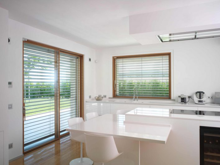 View of the windows in the kitchen with aluminium brise soleil