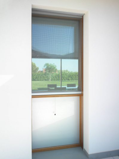 External view of a window with mosquito net