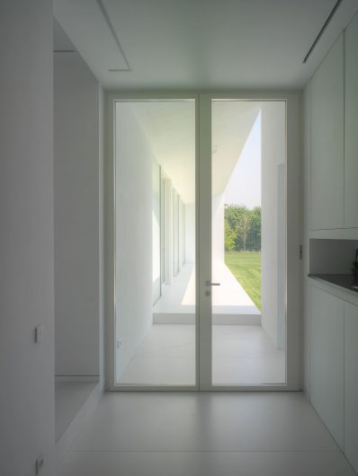 Interior view of the entrance door with two white lacquered sashes