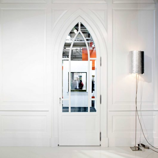 View of a door and a custom-made white lacquered paneling