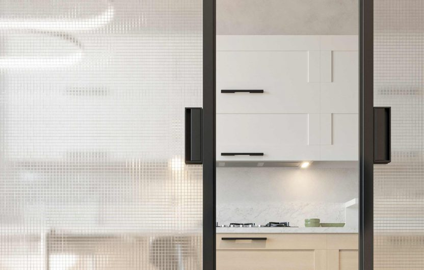 Detail of a two-leaf sliding door with dark gray aluminium handles