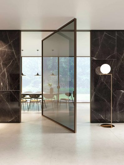 Lady internal pivot door in dark stained oak and smoked transparent glass