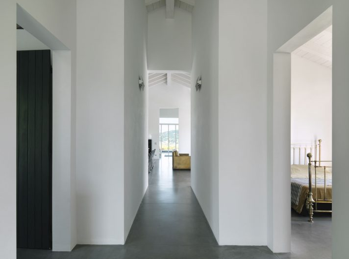 View of the corridor in the sleeping area with a four-leaf French door in the background
